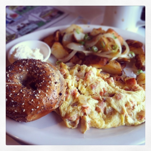 "The ""Leo"" at Saul's: smoked salmon, onions, and eggs with a bagel and cream cheese. With home fries, of course."