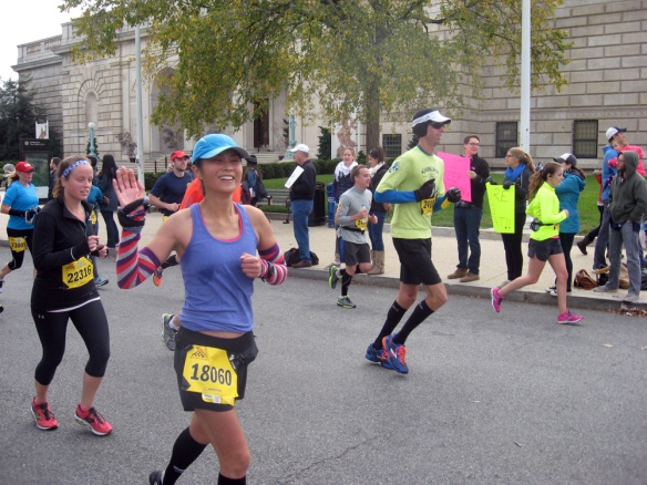 A moment of happiness upon seeing my sister and niece at mile 19. (Photo credit: JS)