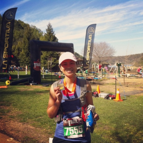 Posing with my medal and my snacks. (photo taking credit: PL)