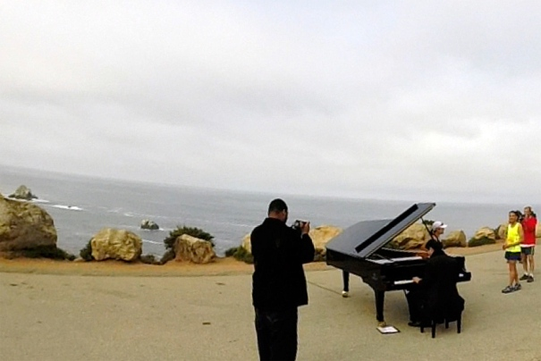 Wait, it's not every day you see a man playing a baby grand piano by the ocean during a marathon?? (Photo credit: Mike)