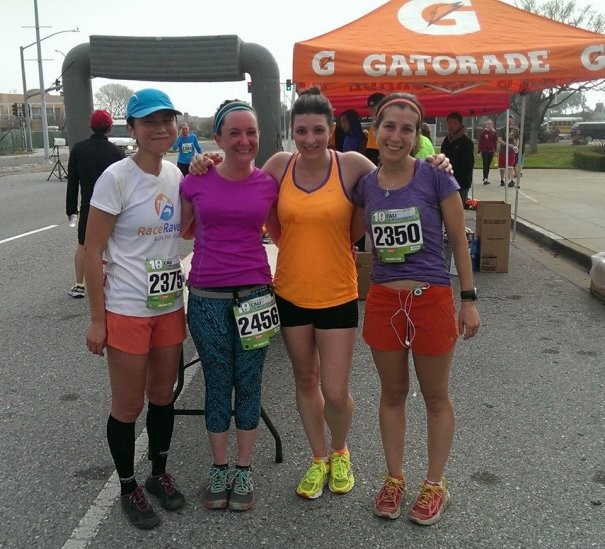 Me, JT, Angela, and Margot post-race.  I've got half of an orange in my left cheek, doing my best imitation of a chubby chipmunk.  (Photo courtesy of Angela.)