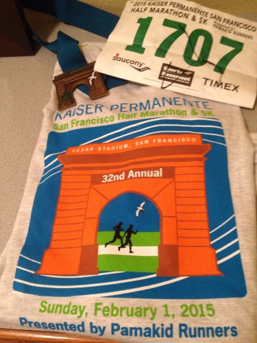 2015 Kaiser swag: long sleeve t-shirt and medal that doubles as a magnet.
