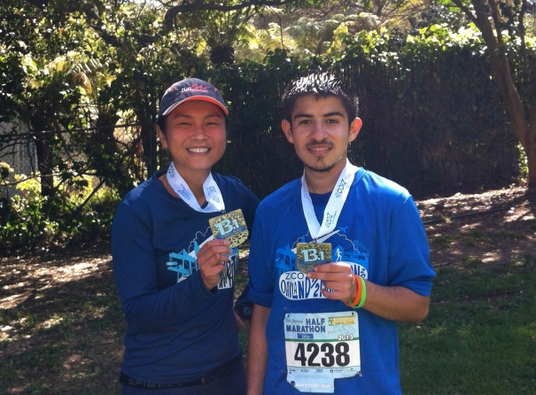 Me and my RBO mentee Alejandro in 2013,  showing off our Oakland Half bling!