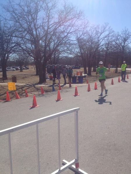 All smiles (and both feet off the ground!) at the finish. (photo credit: Cathryn)